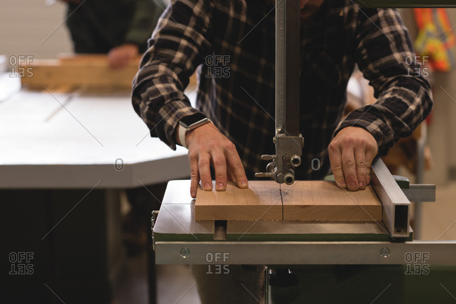 Mid section of craftsman working in workshop