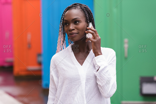 Close-up of fashionable young woman talking on the mobile phone