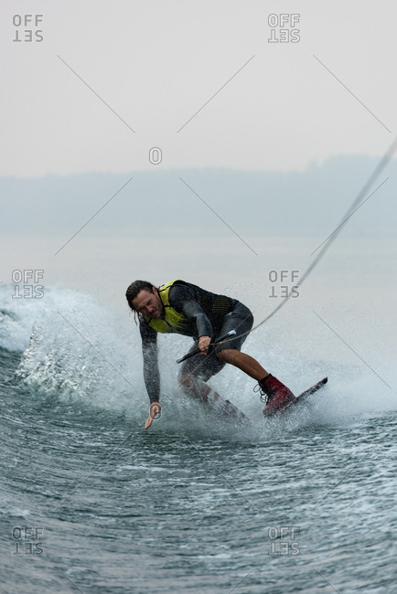 Young man wakeboarding in the river
