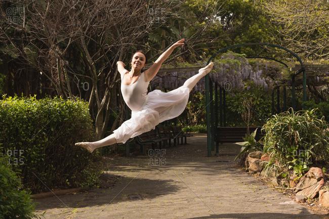 Beautiful urban dancer dancing in the park