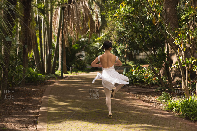 Rear view of urban dancer dancing in the park