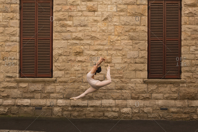 Graceful urban dancer dancing in the city