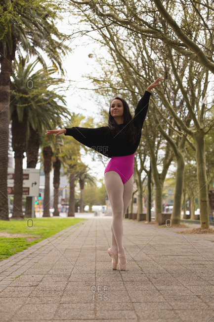 Beautiful urban dancer practicing dance in the city