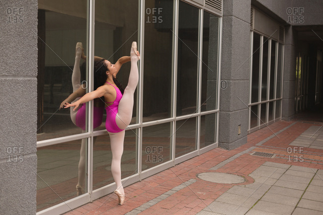 Side view of urban dancer practicing dance in the city