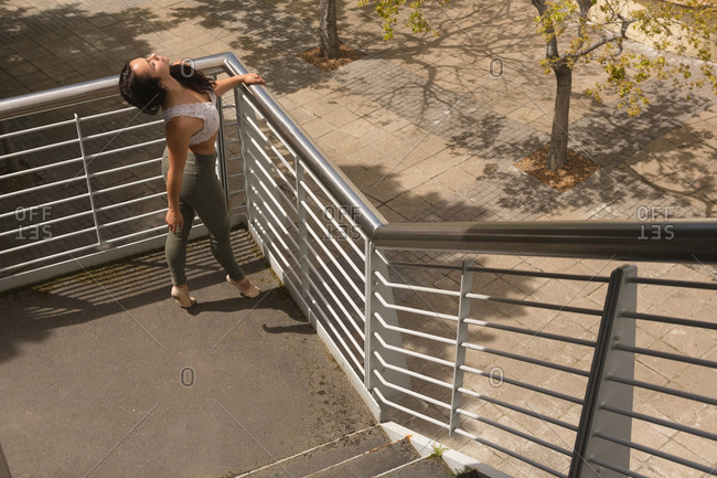 High angle view of urban dancer practicing dance on stair