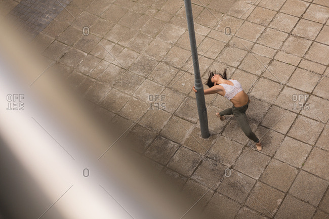 High angle view of urban dancer practicing dance in the city