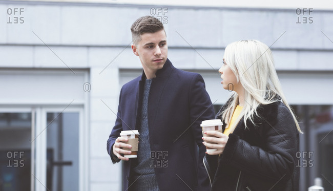 Young couple interacting while having coffee