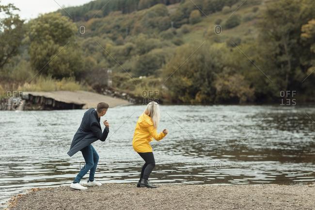 Young couple having fun near river