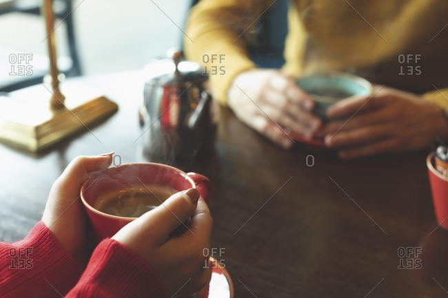 Close-up of couple having coffee in cafe