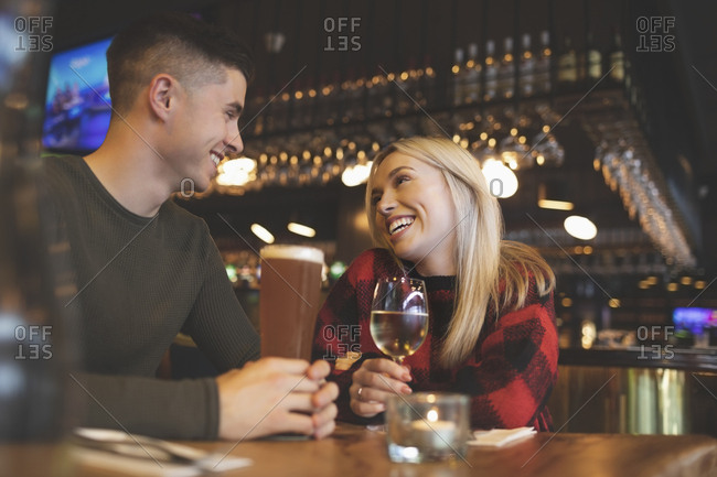 Happy couple having drinks in restaurant