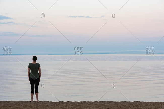 Rear view of woman standing on the beach