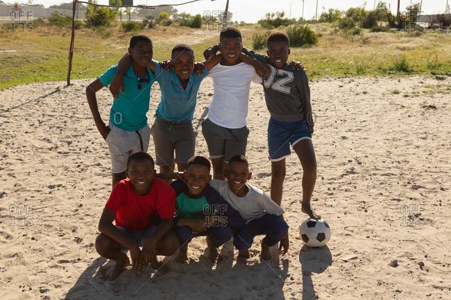 Kids posing together in the ground on a sunny day