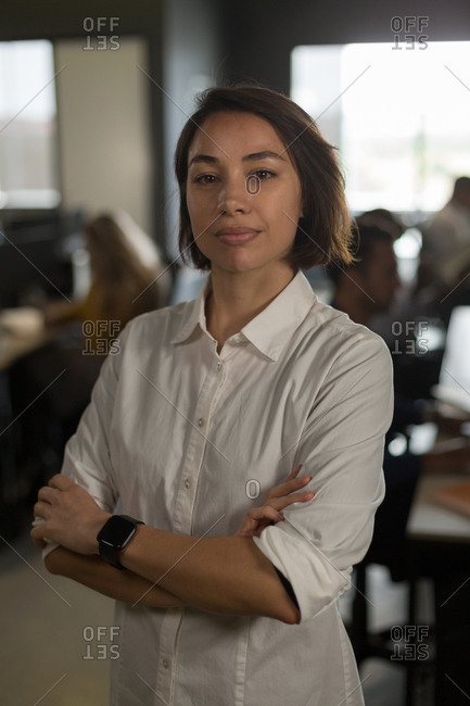 Portrait of female executive looking at camera in office
