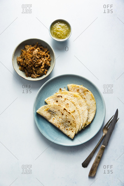 Cheese and onion quesadillas with pork carnitas and green salsa