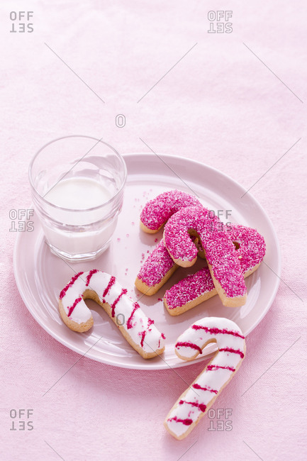 Candy cane cookies with a glass of milk