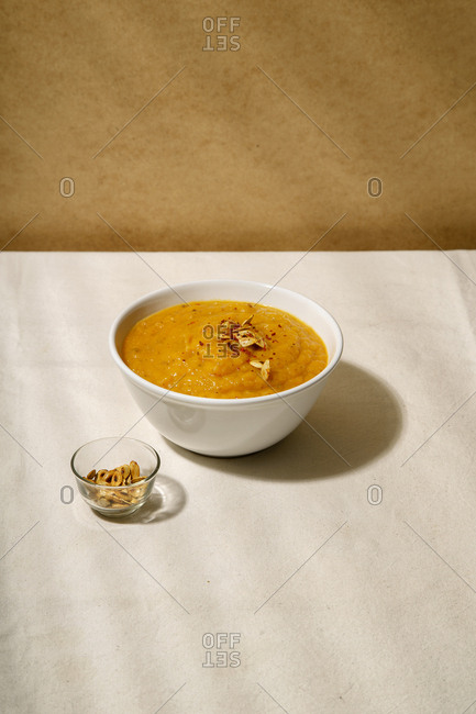 Pumpkin soup on a table covered with linen tablecloth