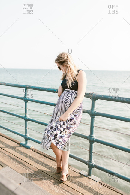 Pregnant woman on a pier in Santa Monica, California