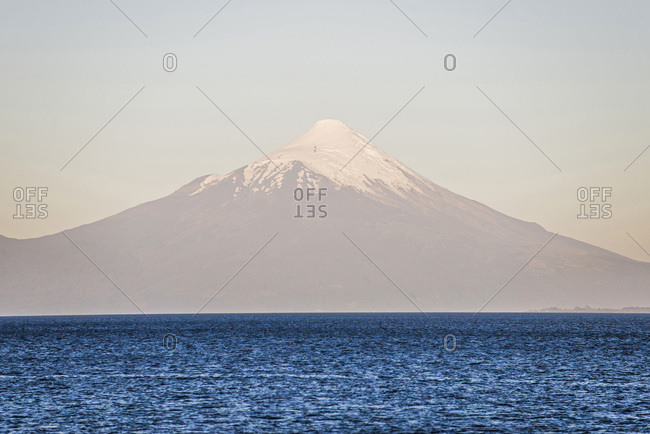 Chile, Los Lagos, Osorno Volcano at sunset, seen over Llanquihue Lake from Puerto Varas