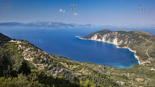 Greece, Ionian Islands, Ithaca, Mediterranean sea, Ionian sea, Greek Islands, Afales bay and Exoghi village on the left.  On the background Lefkada island.