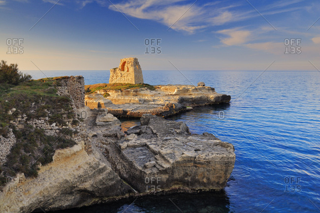Italy, Apulia, Lecce district, Salento, Roca Vecchia, Mediterranean sea, Adriatic sea, Adriatic Coast, The old viewing tower along the Adriatic coast next to the ruins of the Roman archaelogical site