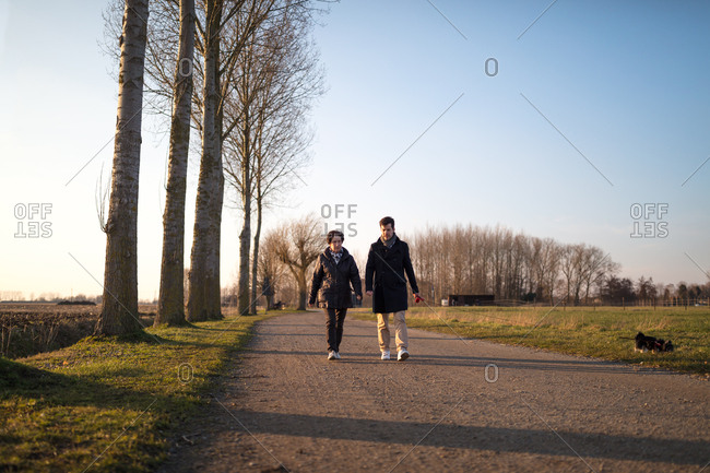 Grandma and son walking in rural nature landscape