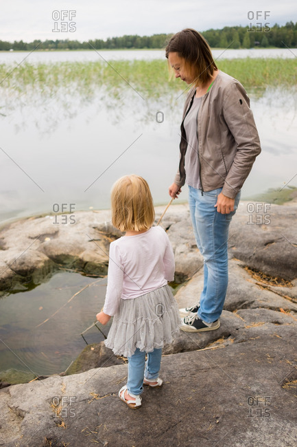 Mother and daughter fishing at a lake