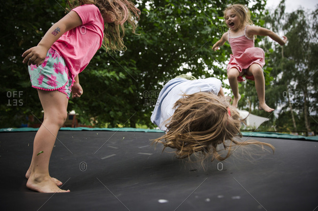 Energetic children jumping on trampoline together