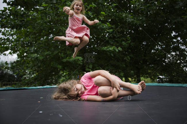 Girl jumping high on trampoline