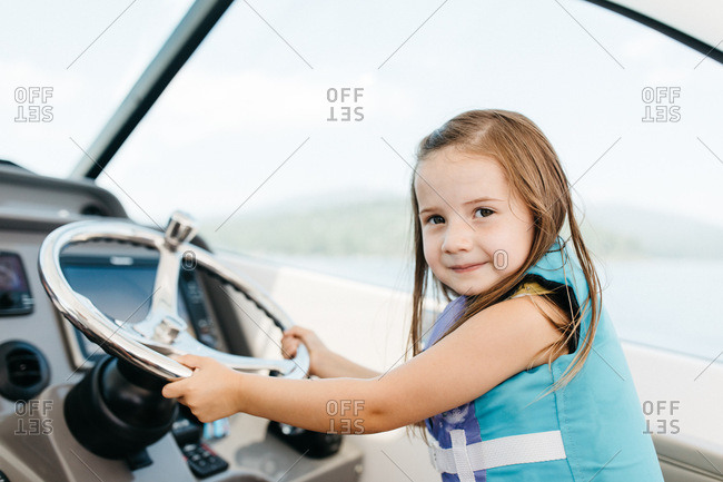 Young girl captaining a boat on Lake Tahoe