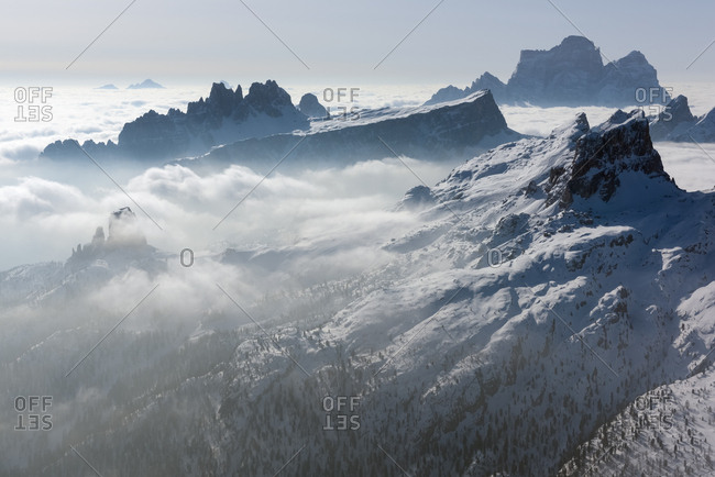 Sunrise from the top of the mountain Lagazuoi towards the Dolomites of Cortina and Zoldana valley.