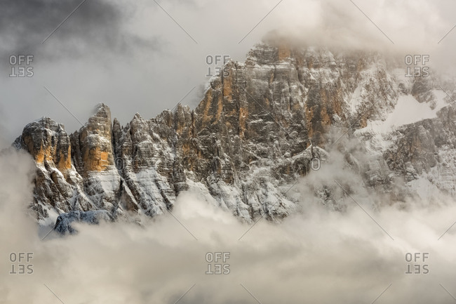 The north-west wall of the Civetta mount wrapped in stormy cloud, Dolomites, Italy