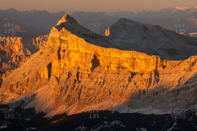 Sunset from the top of Piz Boe in the Sella mountain group towards Sasso della Croce peak, dolomites, Italy