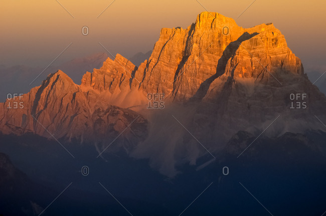 Sunset from the top of Piz Boe in the Sella mountain group towards Pelmo peak, dolomites, Italy