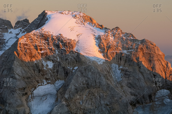 Sunset from the top of Piz Boe in the Sella mountain group towards Marmolada peak, dolomites, Italy
