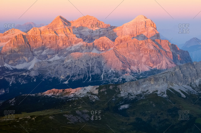 Sunset from the top of Piz Boe in the Sella mountain group towards Tofana mountain group and Lagazuoi peak, dolomites, Italy