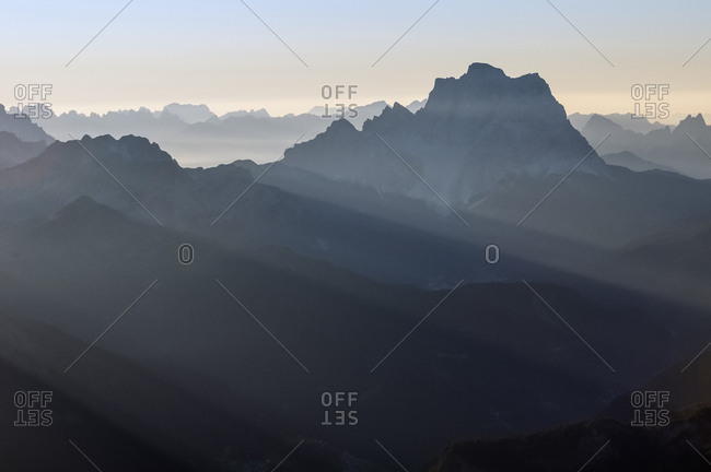 Sunrise from the top of Piz Boe in the Sella mountain group towards Pelmo peak, dolomites, Italy