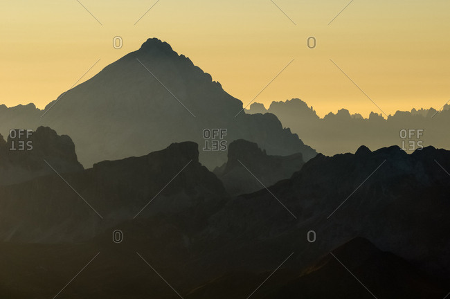 Sunset from the top of Piz Boe in the Sella mountain group towards Antelao peak and dolomites of Cortina d'Ampezzo, Italy