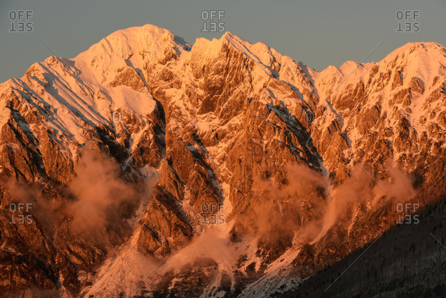 Sunset in the Monte Cavallo mountain range after a heavy snowfall, Tambre, Alpago, Cansiglio forest, Belluno, Prealps, Veneto, Italy, Europe