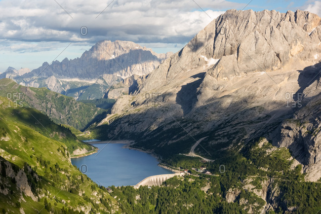 Marmolada mount and Fedaia lake from above, in the backgroundi the Civetta peak, dolomites, Italy, Europe