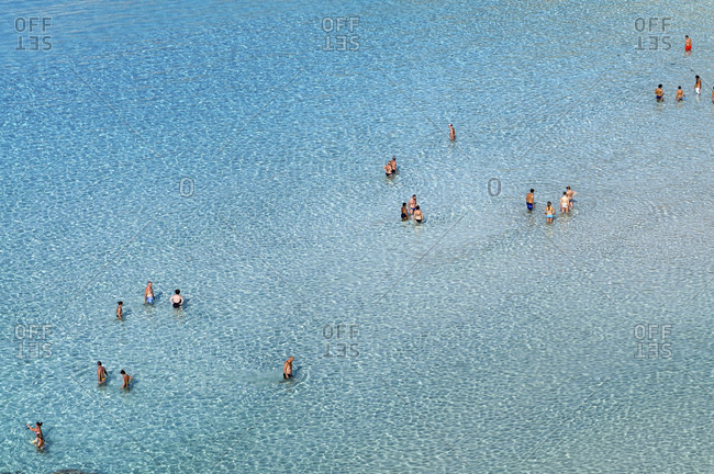 Sicily, Italy - August 25, 2011: The transparencies of the sea of the Isola dei Conigli in Lampedusa island