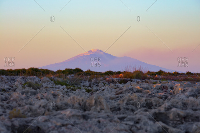 Silhouette of Etna form the cliff of Siracusa, Sicilia