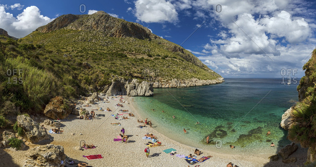 Sicily, Italy - September 26, 2015: Tourists at the Cala Tonnarella dell'Uzzo beach, in the Zingaro nature reserve