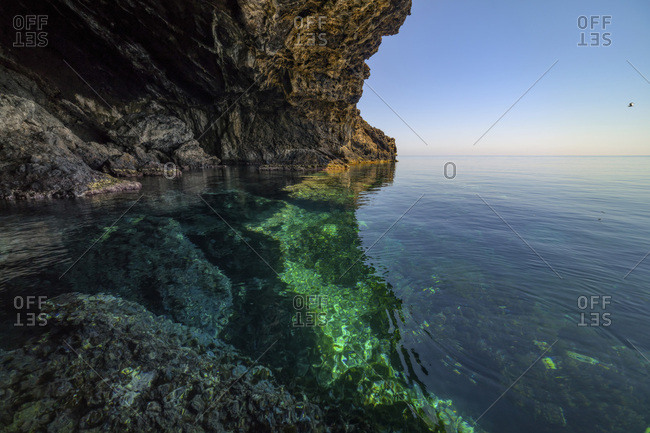 Transparent water and cliff in the sea of Ustica, Sicily, Italy