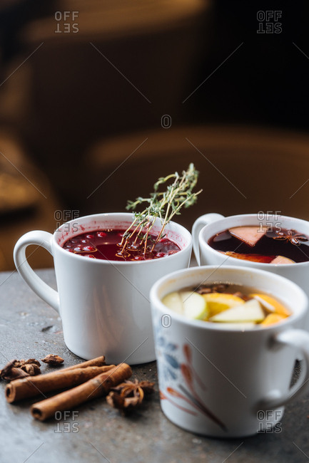 Variety of mulled wines served in mugs
