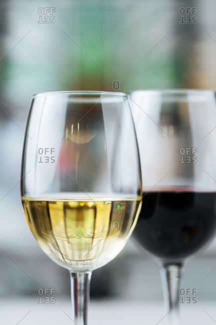 Two glasses with white and red wine
