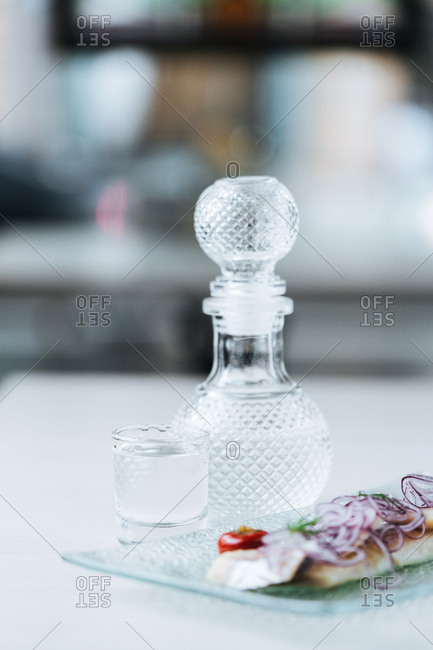 Decanter and appetizer topped with red onions