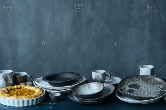 Still life with ceramic dishes and freshly baked cobbler