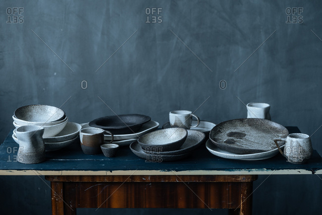 Still life with ceramic dishes on a blue table