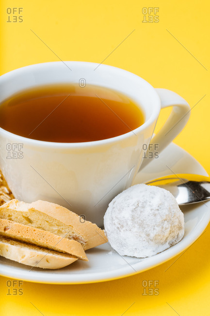Close up of a variety of cookies with tea