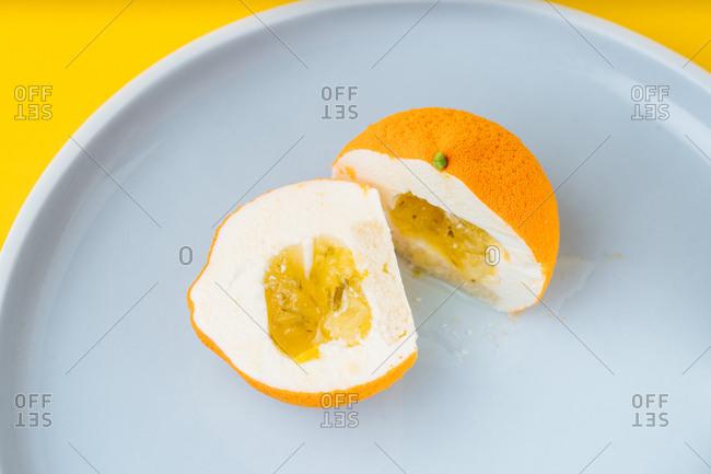 Orange shaped gourmet dessert